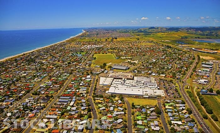 Aerial;Mount Maunganui;Omanu Beach;Bay of plenty;blue seablue skysandy beaches;sea;sea fishing;harbour;bachs;holiday homes;sand dunes;high rise buildings;cruise ships;tourists;holiday makers