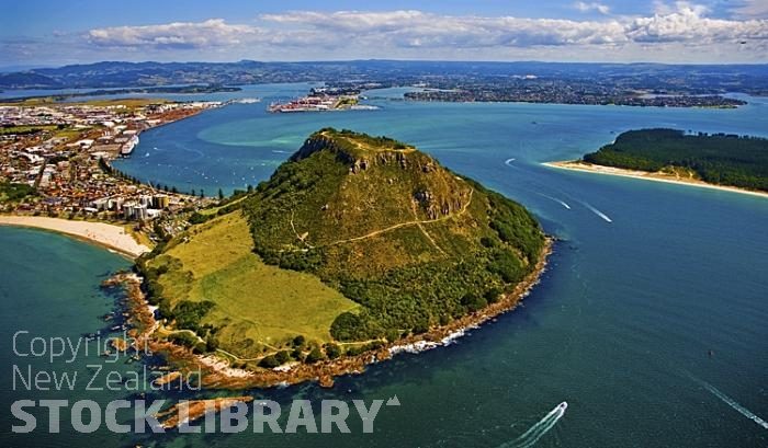 Aerial;Mount Maunganui;Bay of plenty;blue seablue skysandy beaches;sea;sea fishing;harbour;bachs;holiday homes;sand dunes;high rise buildings;cruise ships;tourists;holiday makers