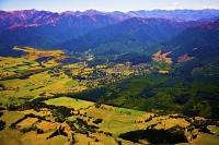 Aerial;Hanmer_Springs;green_fields;paddocks;brown_hills;hills;mountains;blue_sky