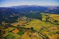Hanmer_Springs;Aerial;green_fields;paddocks;brown_hills;hills;mountains;blue_sky