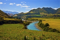 Hanmer_Springs;green_fields;paddocks;brown_hills;hills;mountains;blue_sky;Hanmer