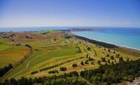 Aerial;Kaikoura_Peninsula;seaward_Kaikoura_Range;green_fields;paddocks;brown_hil